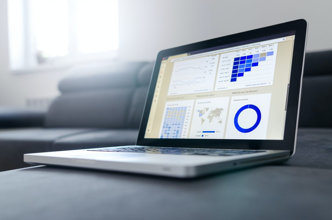 a laptop with marketing analytics displayed on the screen.