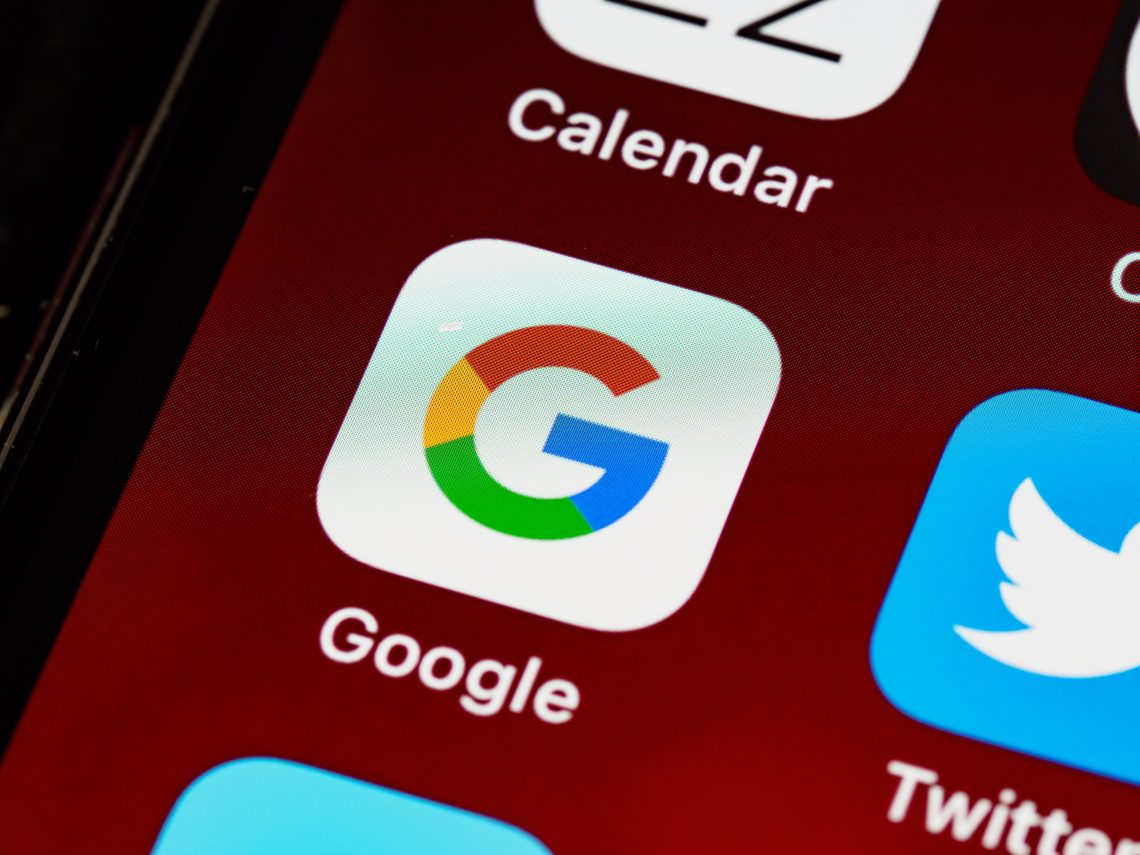 smart phone with the Google app icon on the screen.